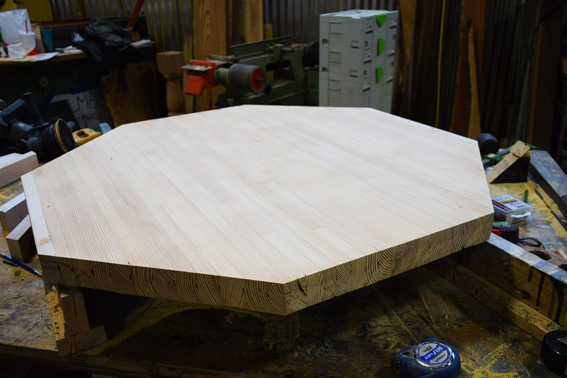 Section of bowling alley cut to the desired shape for table top.