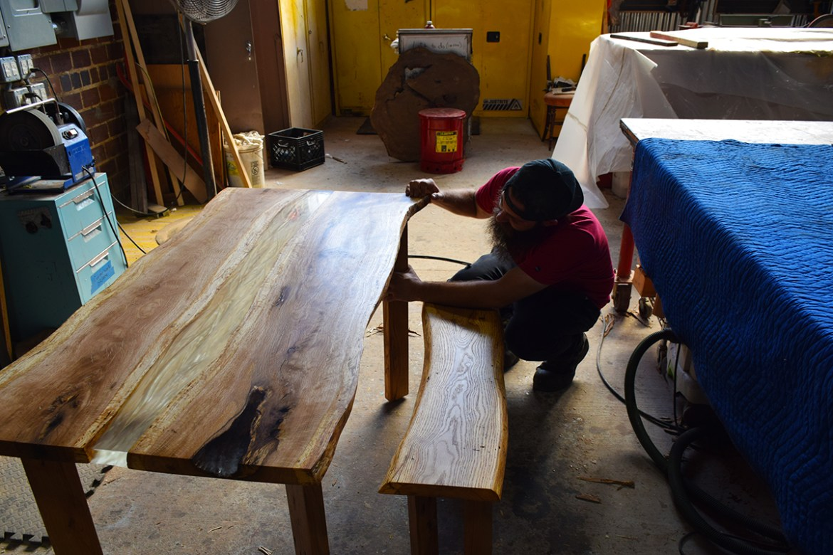 Parker giving the table legs one last inspection before sending this set home with it's new owner.