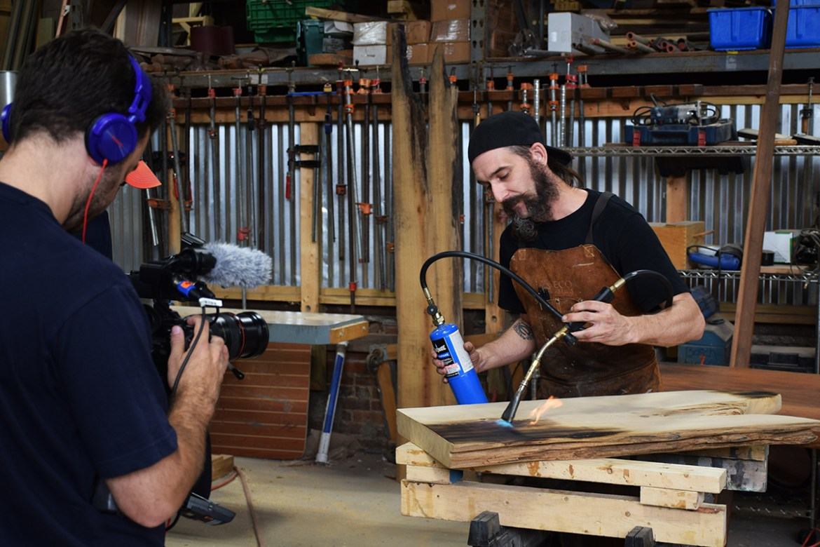 Billy demonstrates the flame technique for a TV camera crew.