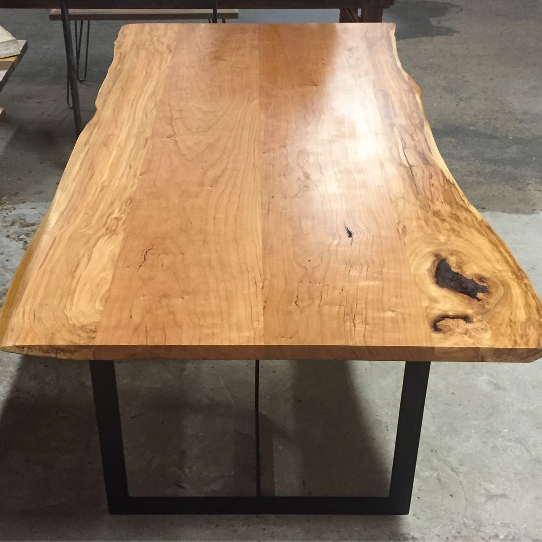 Here's another beautiful Live Edge Cherry table with metal bases.