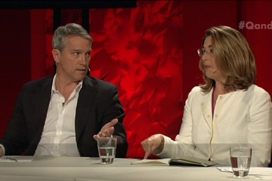 Man and a woman talking on a panel show