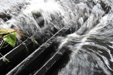 Water rushing through a storm drain