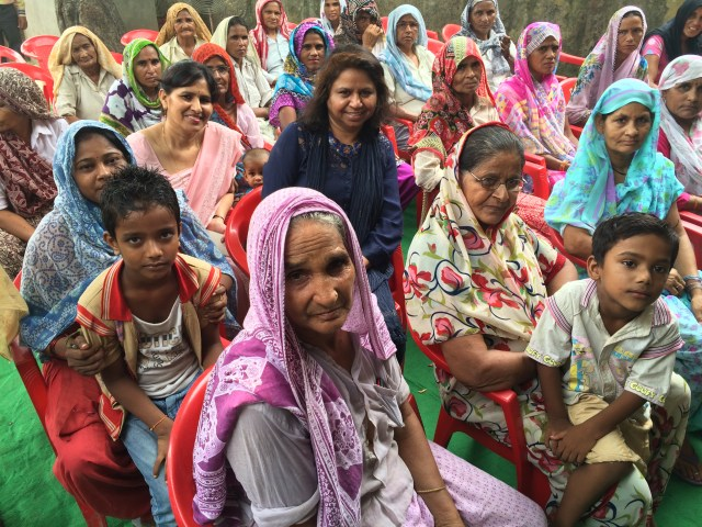 Anu Kumar sits with other women in a workshop setting where she teaches them about pesticide esposure.