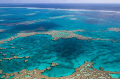 Corals and ocean water on the Great Barrier Reef as seen from the air