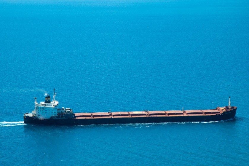 A bulk carrier on bright blue water