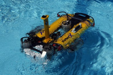 close up of yellow, mini-submarine on water surface