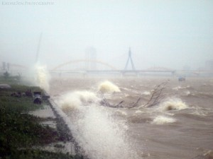 river waters lash at bank in cyclone