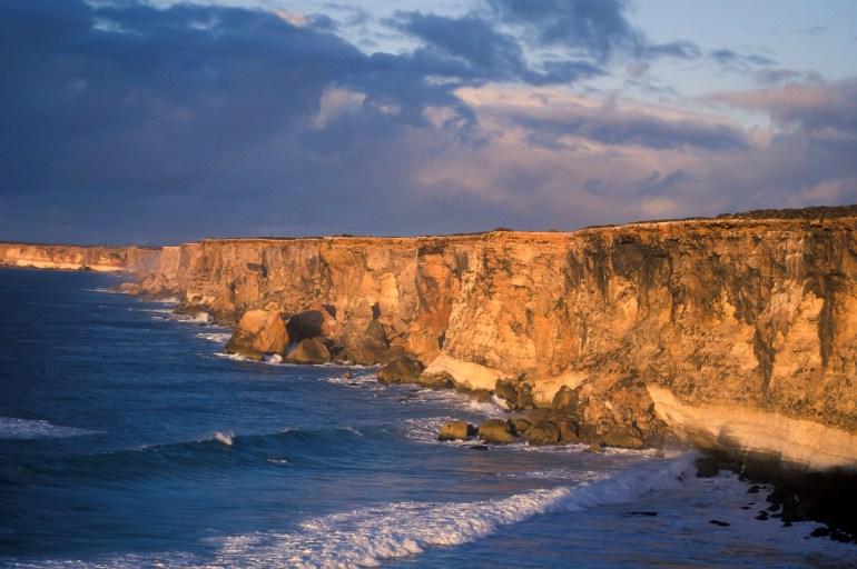ocean cliffs at sunset