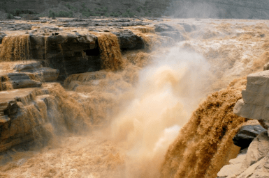 polluted water cascading over river waterfall