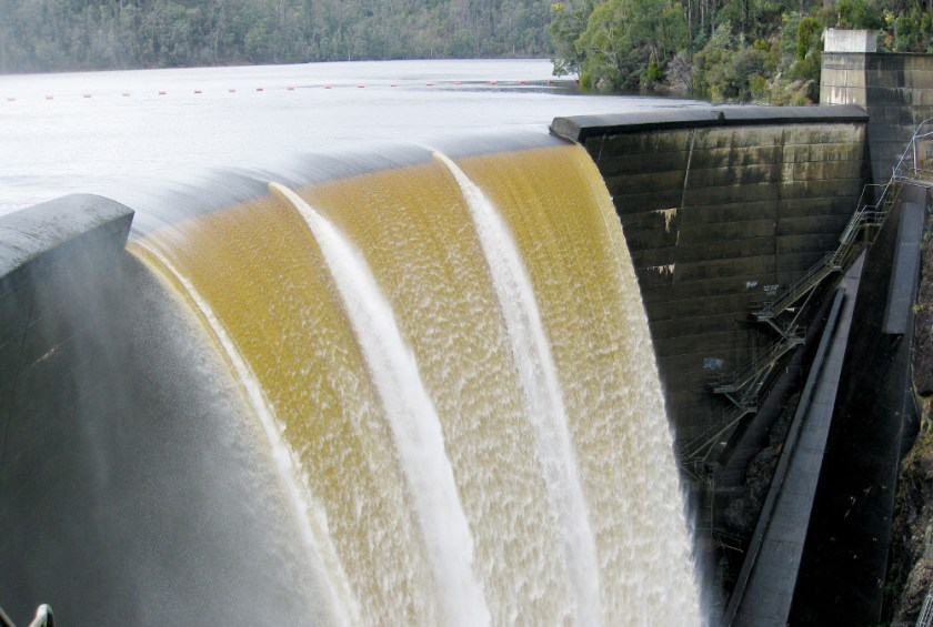dam overspill with torrent of water falling over the dam wall