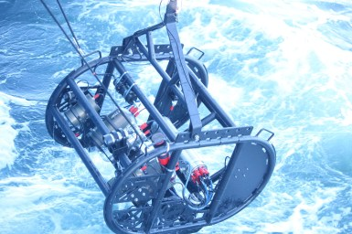 equipment being winched out of ocean
