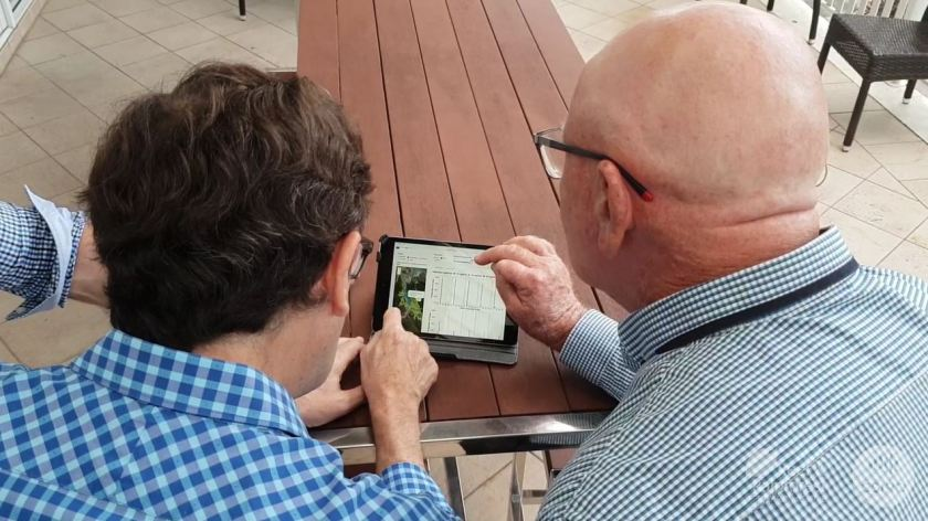 Two people looking at an app on a tablet