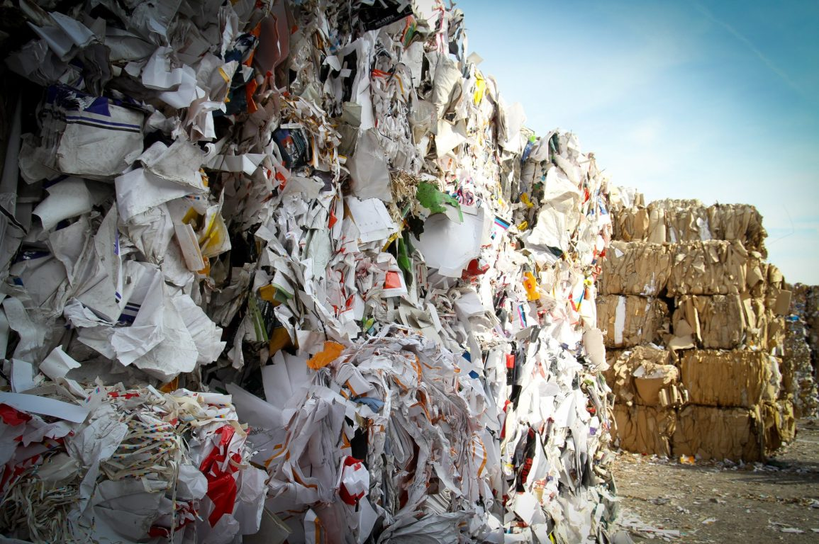Picture of bundles of recycled paper. The roadmap recommends reducing single-use paper.