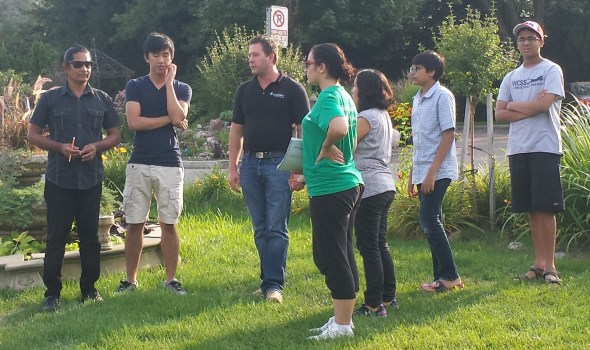 Participants discussing water flow at the future garden location