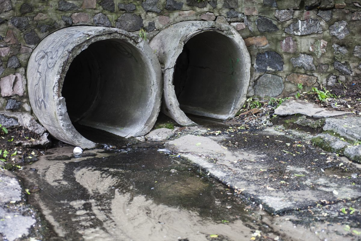 Two large run-off pipes discharging water