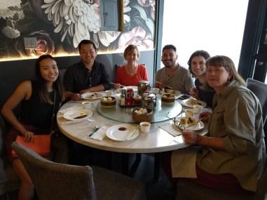 Pheng Lor enjoying dim sum with ECOSS staff. Photo Credit: Will Chen / ECOSS.