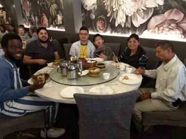 MaKail Crawford enjoying dim sum with ECOSS staff. Photo Credit: Will Chen / ECOSS.