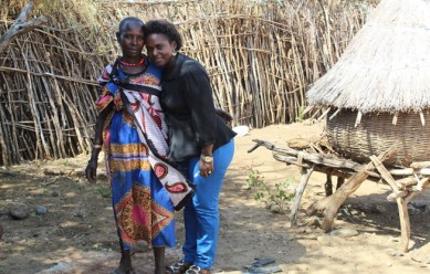 Regina(right) with Phillo(Nalem) program officer ECO as she's welcomed warmly into Regina's homestead