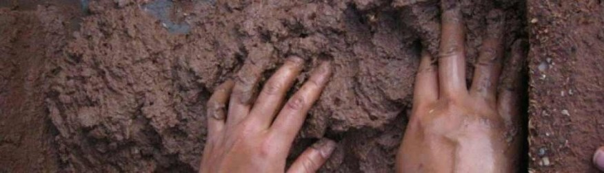 cropped-cropped-hands-in-mud