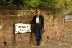The Beatles lived near Penny Lane in Liverpool. That's me, Evelyn Kanter, posing for a souvenir photo.