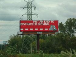 Highway billboards secretly watching us