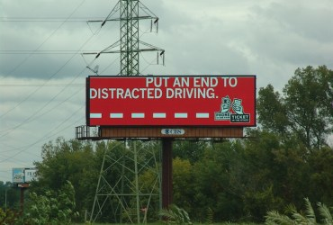 Highway billboards secretly watching us