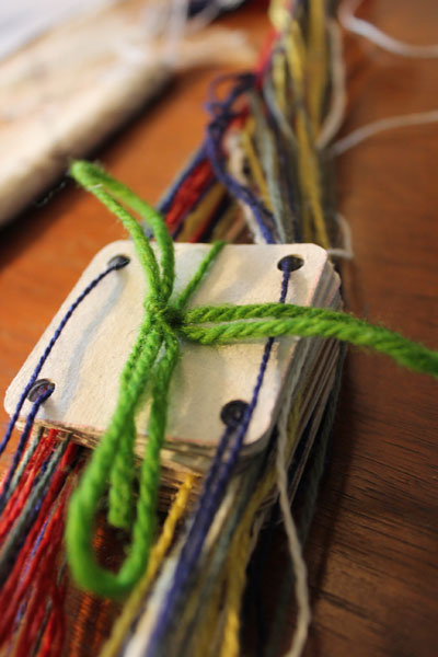4. Tie the cards together when done so they do not move around while you prepare the other parts for weaving.