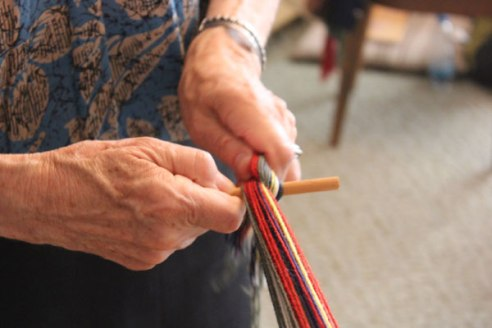 7. Bunch-up all the loose ends and tie them around a small straight stick. Attach an extra piece of long strong thread to this stick.