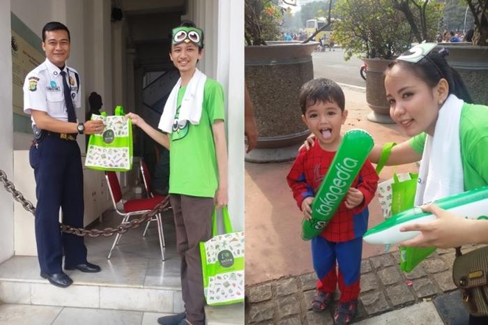 """Berbagi Senyum, """"Pasukan Hijau"""" Tokopedia Ramaikan Parade Hari Pelanggan Nasional 2014"""