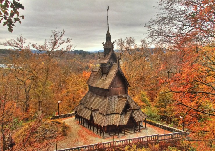 Postcard of a stave church in fall