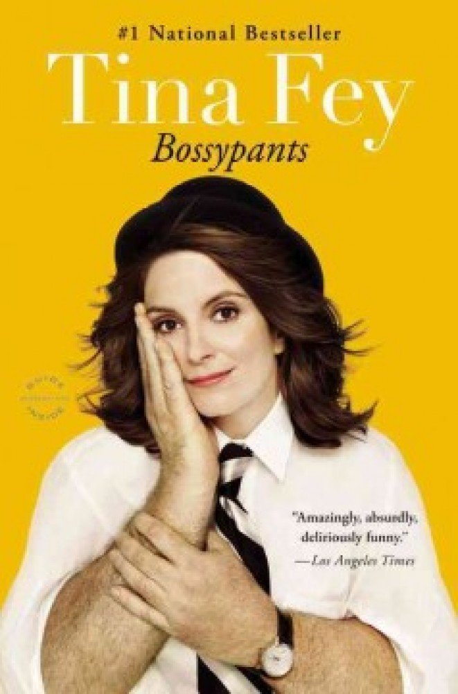 The cover of Tina Fey's Bossypants: Tina's head with a black bowler hat on with a man's arms as her own.  She's dressed in a white shirt and a black and white diagnal striped tie.