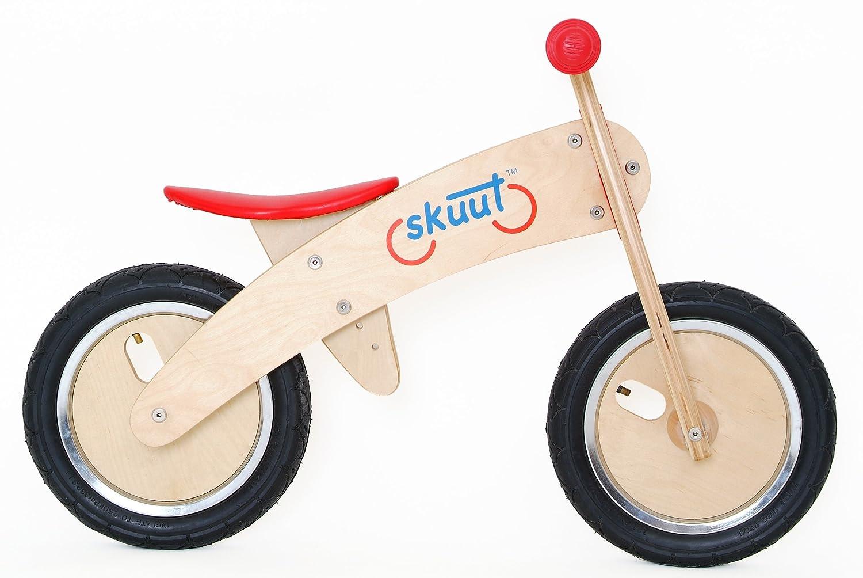 A wooden balance bike