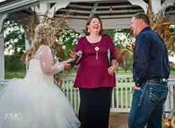 Officiant laughs during ceremony.