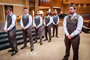 The groomsmen and groom are a study in different expressions waiting for the bride