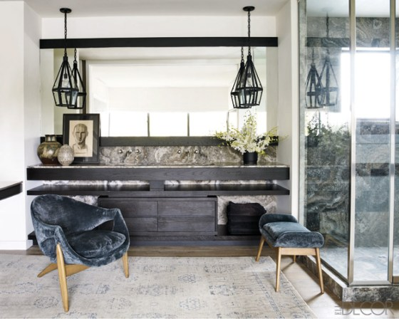 The cabinetry and mirror frame in Courtney Cox's master bath are ebonized white oak, the pendant lights are custom made, and the sink fittings are by Waterworks; the chair and ottoman are upholstered in a velvet by Rose Tarlow Melrose House, and the artwork was done by Cox's father while he was in high school. To tour the rest of her beautiful home, click here.