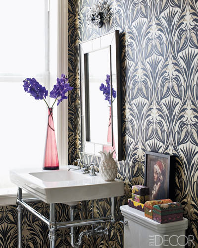 The powder room in actor Anthony Edwards and beauty maven Jeanine Lobell's Manhattan apartment is dressed in a Stark wallpaper; the large-scale pattern breathes life into this small space. Tour this home.