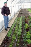Allen discusses the finer points of harvesting claytonia.