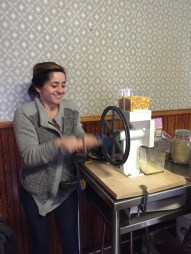 Gianna milling corn!