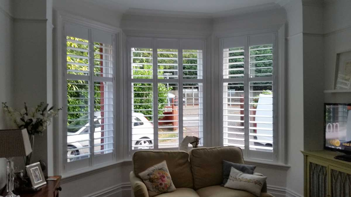 Window Shutters For Family Room And Three Sided Bay Window