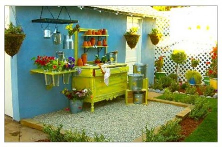 Repurpose an antique dresser as a potting table!