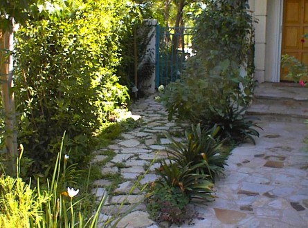 flagstone walkway entry to home