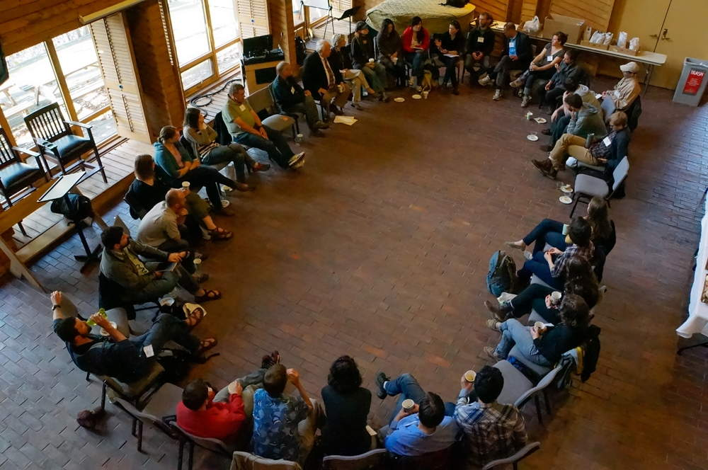 """CHE graduate students and faculty members gathered in a circle of interdisciplinary conversation during our place-based workshop on """"Landscapes of Extraction"""" in May 2014. Photo by William Cronon."""