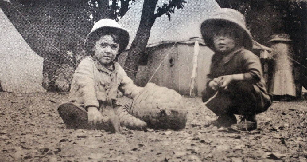 """Carl (""""Bapu"""") Taylor (on right), and his brother, John C. Taylor Jr., with an Indian anteater captured after it wandered into camp. Circa 1919. Photo by Beth Taylor, and taken from India: Dr. John Taylor Remembers the Period from 1914-1967 (World Presbyterian Missions, 1973)."""