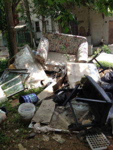 Garbage that is illegally dumped behind vacant homes in Baltimore. Photo by Dawn Biehler, 2015.