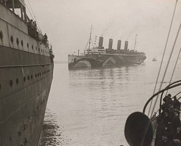 The Argentina, center, nearly struck a coast guard cutter in 1922 during her race through the fog. Wikimedia Commons.