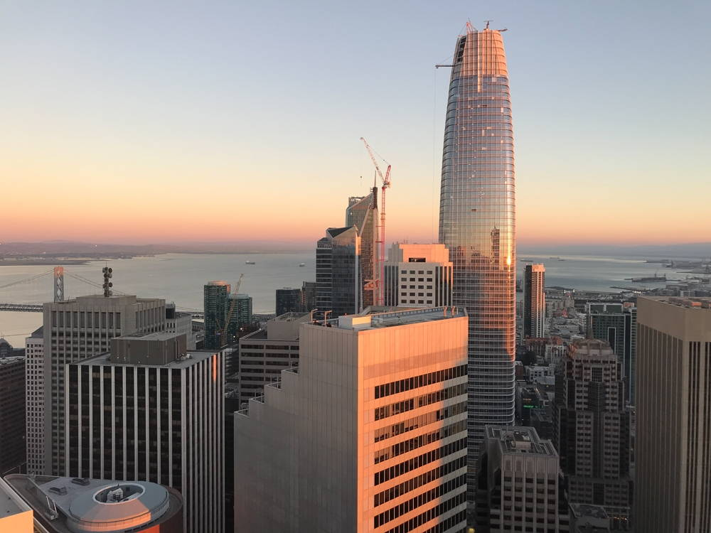 A view of the San Francisco skyline including the Millenium Tower and the Salesforce Tower, which is under construction in this image.