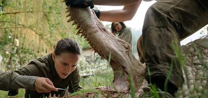 Natalie Portman inspects a crocodile in the film Annihilation