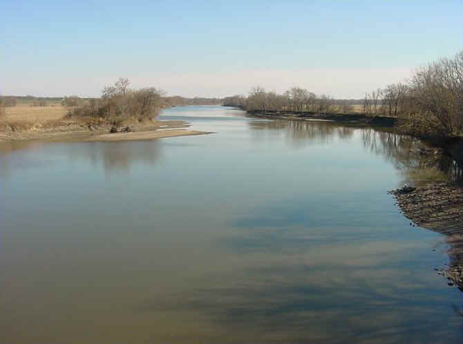 The Des Moines River fills the foreground and winds into the background.