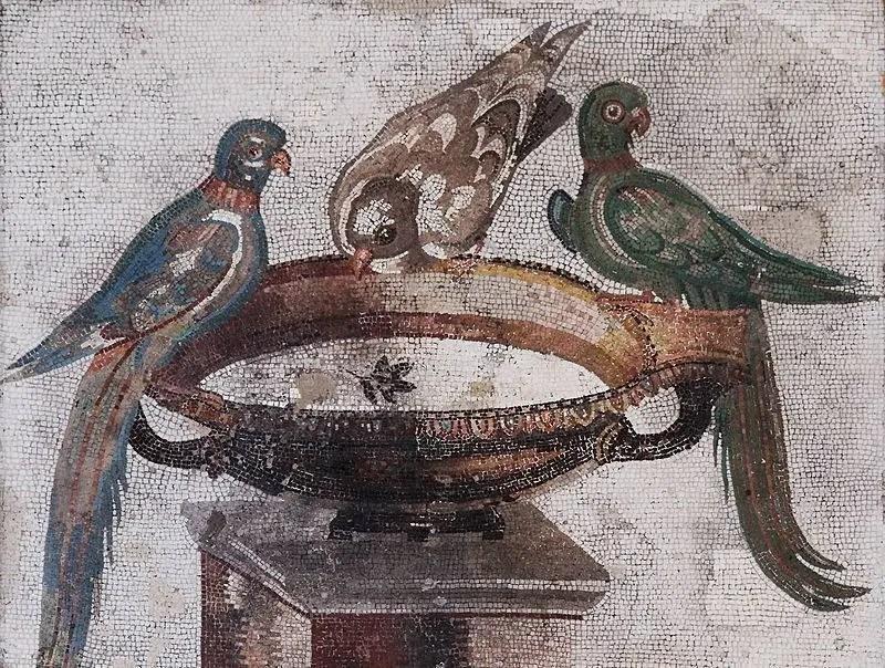 In this mosaic, a blue and tan bird (left), a green bird (right), and a brown bird (center) rest on a bird bath.