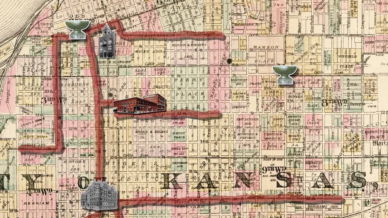 Colorful portion of a map of Kansas City, with icons of buildings and red lines drawn on it to mark different routes of animals and humans.